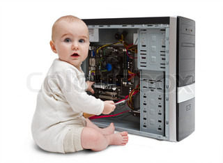 young child working on open computer