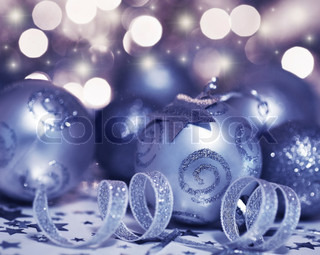 Holiday background with Christmas tree bauble ornament and star decoration over abstract defocus lights