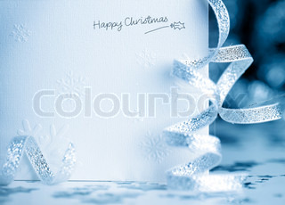 Beautiful blue happy Christmas card, winter holiday background, decoration postcard with snowflakes & ribbon