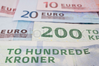 Close up of danish krone and Euro bank notes