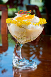 Ice cream dessert with kiwi and orange decorated with butterfly