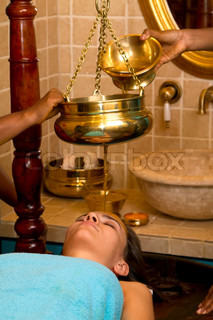 indian doctors doing traditional ayurvedic oil head massage
