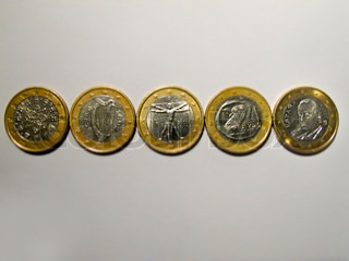 Euro coin, presented in different conditions, for different countries, symbolizing issues of the european financial crisis