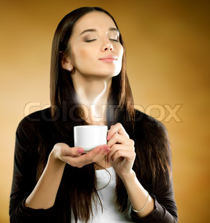 Woman with coffee cup on a brown background