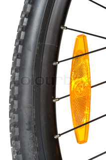 Close up of a mountain bike wheel Focus is on the reflector