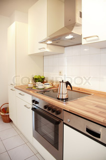 Kitchen interior in family house in white