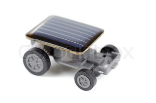 Solar powered toy car on a white background for concept
