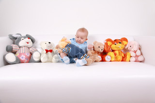 Portrait of cute baby with plenty of toys