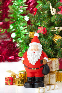 Christmas Toy Santa Claus with presents and christmas tree