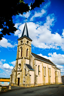 typical church on a sunny day with clouds