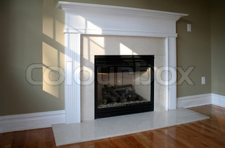 Fireplace in sunny room with white mantle ambient window light
