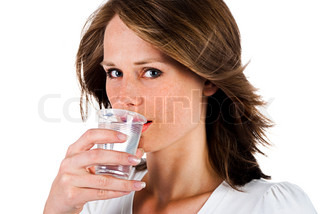 woman drinking water from plastic cup, isolated on a white background