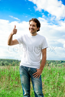 man showing thumb up on a meadow