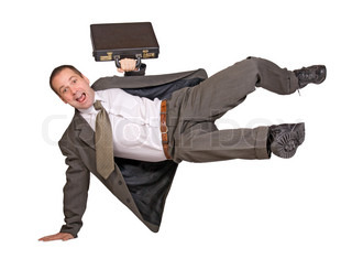 Businessman jumping with suitcase