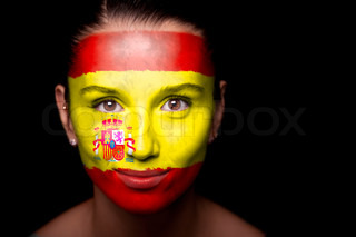 Portrait of a woman with the flag of the Spain painted on her face