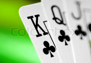 playing cards on a colorful green soft background