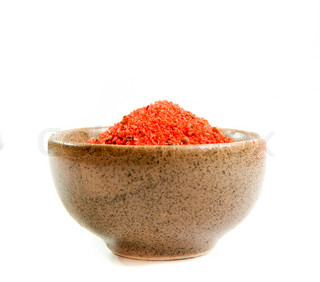 red exotic spices in a ceramic bowl isolated on white