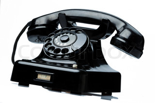 an old, old landline telephone phone on a white background