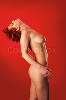 portrait of beautiful woman with a make-up on a red background