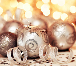 Silver Holiday background with Christmas tree bauble ornament and star decoration over abstract defocus lights
