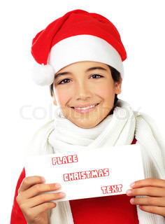 Happy Santa boy smiling, portrait of a cute teen holding blank card isolated on white backgroung, kid wearing red Christmas hat, winter holidays celebration