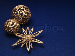 Christmas background of dark blue color with zoltistymi decorations for a fir-tree