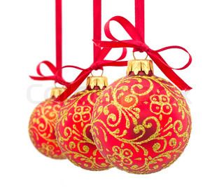 Three red Christmas balls in a row Isolated on a white background