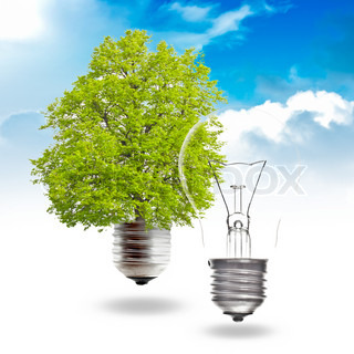 Electric light bulb and green light bulb on a sky background The concept of renewable energy