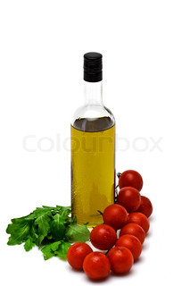 bottle of olive oil with cherry and arugula