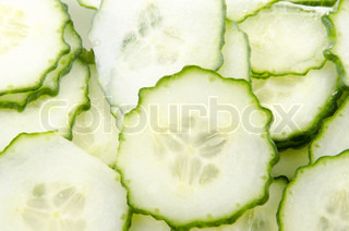an organic cucumber cut into thin slices