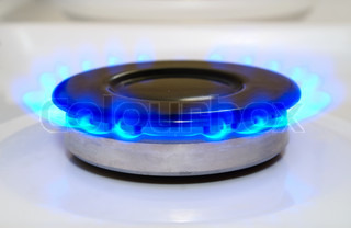 gas burner with a flame burning home plate
