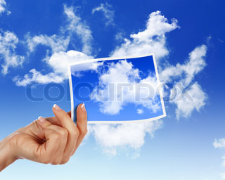 Image of light blue sky with white cloudes with frames