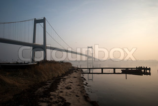 Small wooden bridge and big suspension bridge from Fredericia in Denmark
