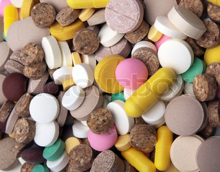 the medical background - heap of colored tablets