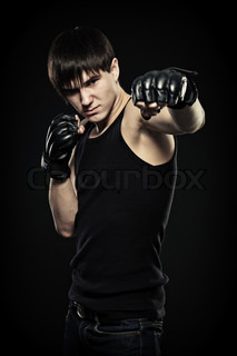 guy in the fighting gloves, isolated black background