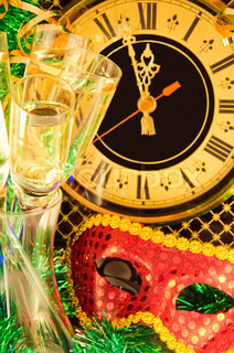 Christmas card Glasses of champagne on New Year's Eve against an ancient wall clock