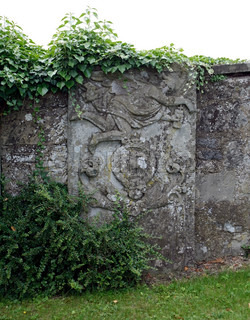 old stone relief on a wall