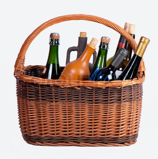 Wine bottles in a basket on a white background