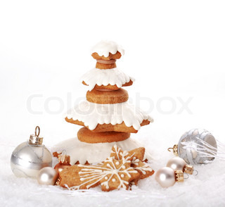 Sweet gingerbread tree for Christmas on the snow