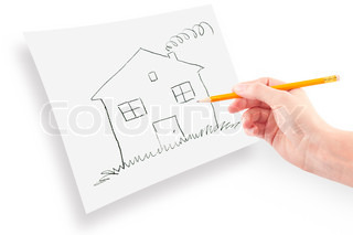 woman's hand with the pencil drawing the dream home on a white sheet of paper