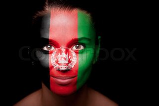 Portrait of a woman with the flag Afghanistan painted on her face