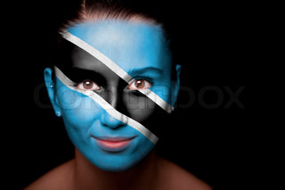 Portrait of a woman with the flag of the Botswana painted on her face