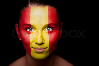 Portrait of a woman with the flag of the painted on her face