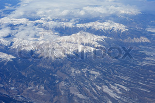 aerial view of mountains with snow on them