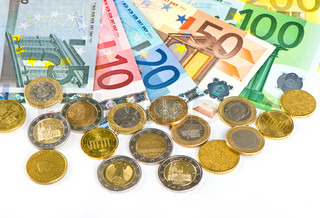 close up of euro currency. coins and banknotes. money background