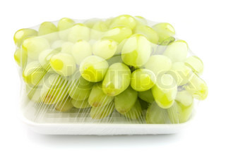 vacuum packed sweet grapes on a white background