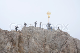 Hikers at the cross on the summit of Zugspitze Mountain, Alps Germany Photo taken at 5th of July 2009