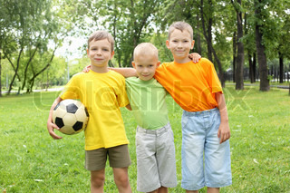 Boys in the summer park with a football ball