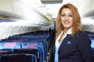 air hostess stewardess in the empty airliner cabin