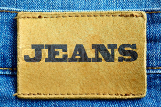 Blue jeans and leather label with word